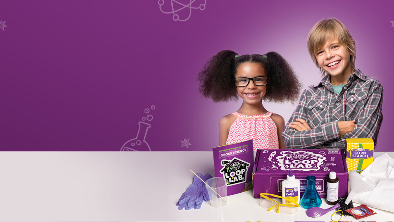 a boy and girl standing behind a Mad Science Loop Lab box with all ingredients displayed